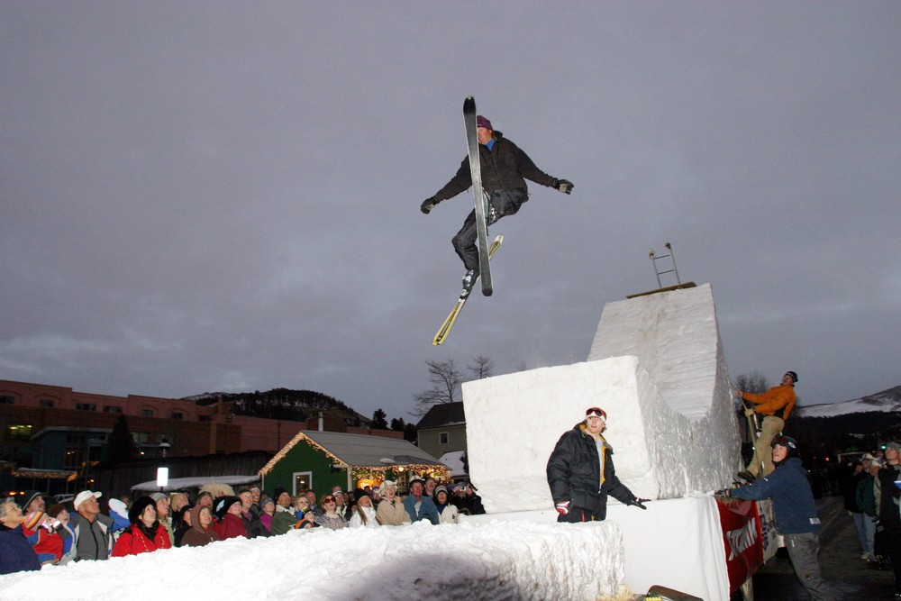 A skier goes off a jump in Breckenridge, Colorado