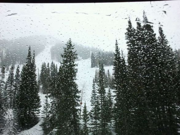 It looks like it may be snowing up top, but it's raining at the base.  Think I'll skip today.