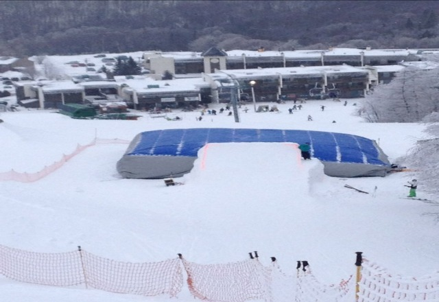 Snow still falling on the hill. Cool jumping going on!