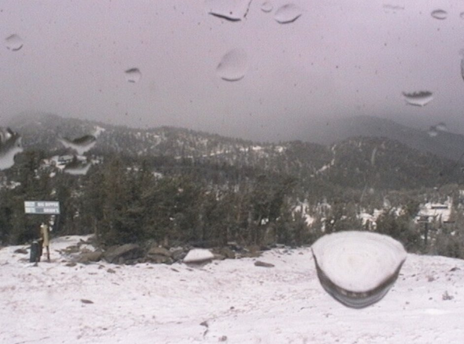 While raining at lake level, it began snowing at the top of Heavenly Mountain Resort. Photo from Heavenly's new snow stake and camera located near the top of Dipper Express.