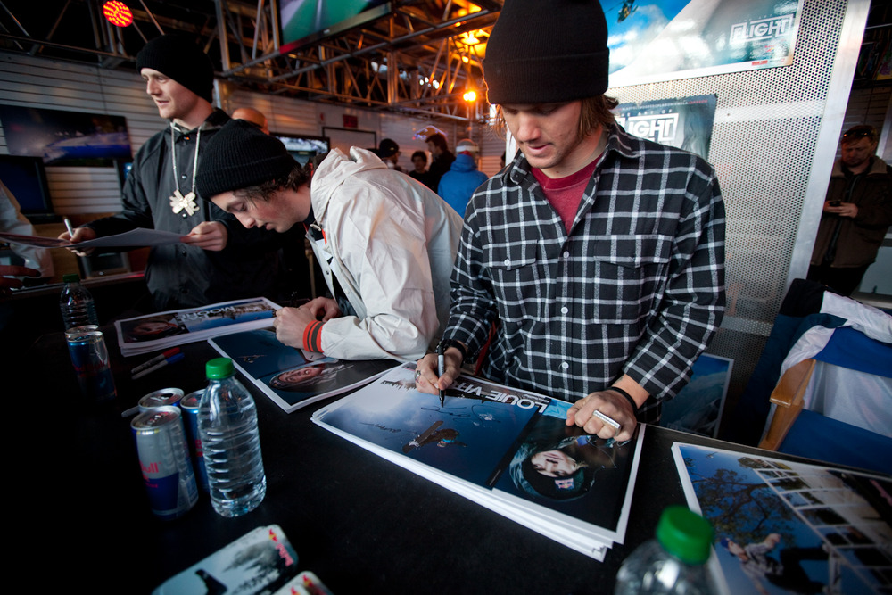 Louie Vito signing posters in the Red Bull tent. Photo by Sasha Coben