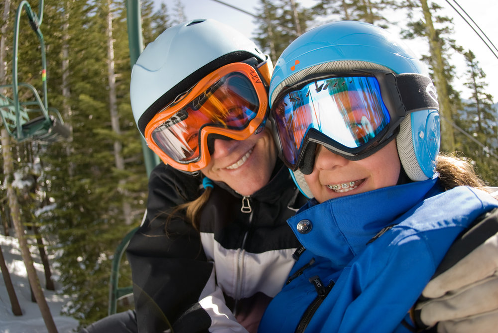 A mother and daughter take a photo at Alpine Meadows, California