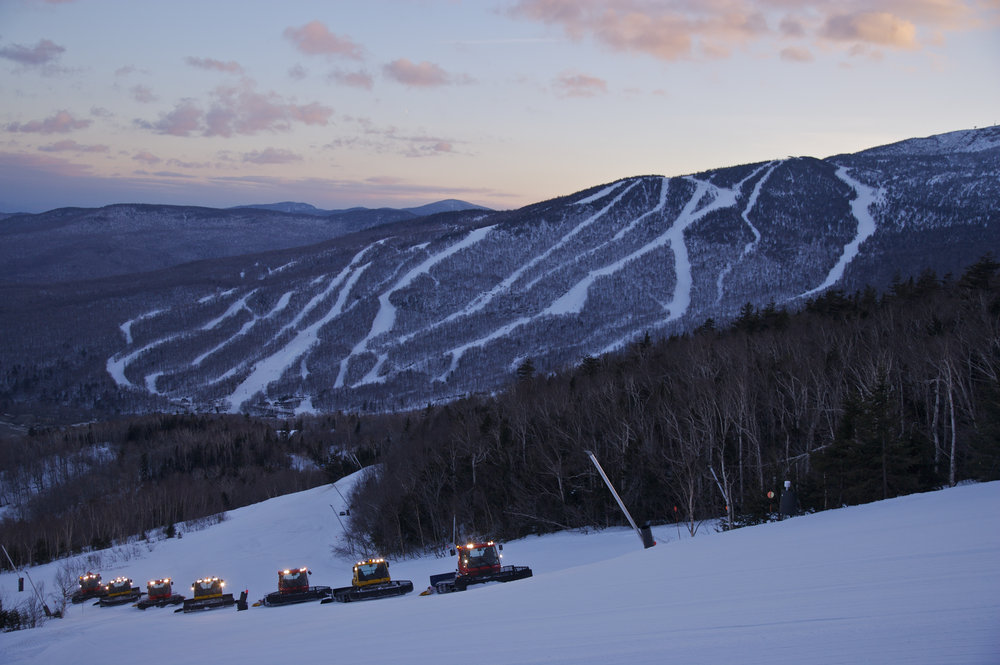 Snowcats move up the mountain at Stowe Mountain Resort, Vermont