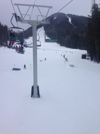 Needs a bit more snow. Lots of people on the hill and chairs moving pretty slow