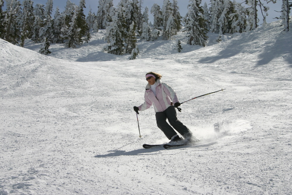 A skier cruises down the mountain at Mt. Baldy Ski Resort, California