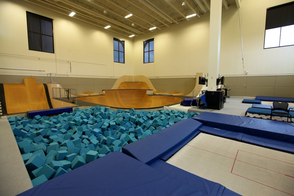 Trampolines and foam pits provide a secure indoor setting for mastering aerial maneuvers. Photo by Tim Shisler.