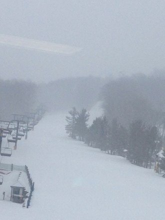 It's snowing and the slopes are groomed. Perfect day to go snowboarding/skiing.
