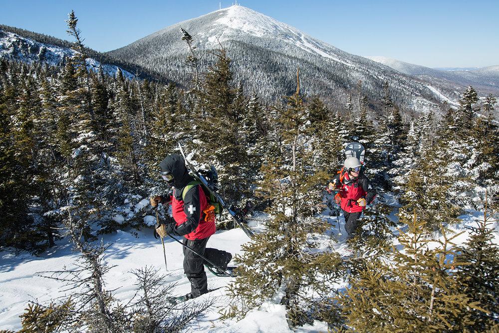Patrollers hike Burnt Mountain summit at Sugarloaf. - ©Sugarloaf