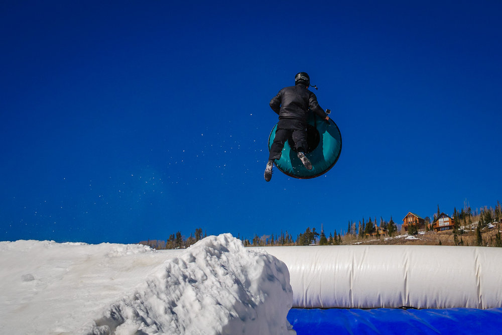 Getting some air time on Brian Head's Extreme Tubing BagJump.