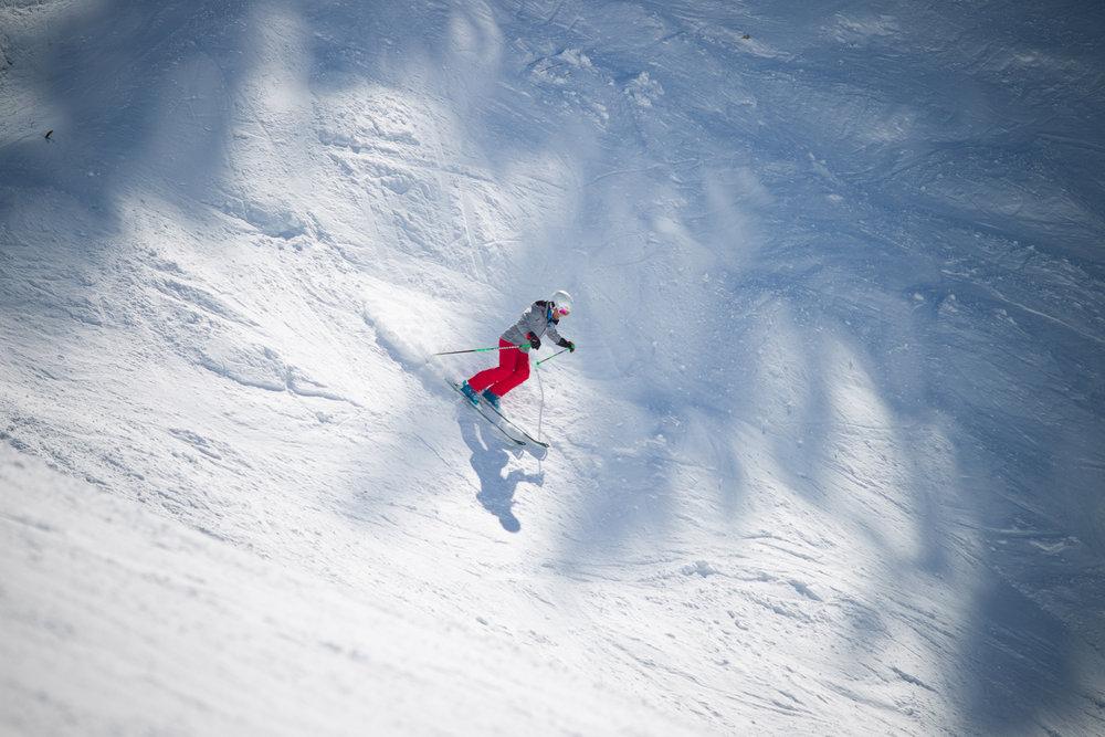 A lone ski tester takes a lap.