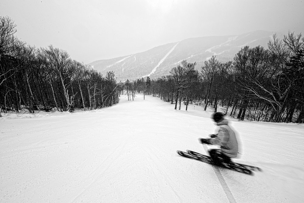 Lone skier enjoying the solitude of mid-week skiing at Sugarbush.