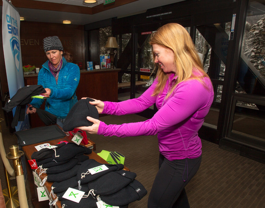 Testers got a second round of swag during the OnTheSnow après at the Seven Summits Club at Snowbird.   - ©Cody Downard Photography