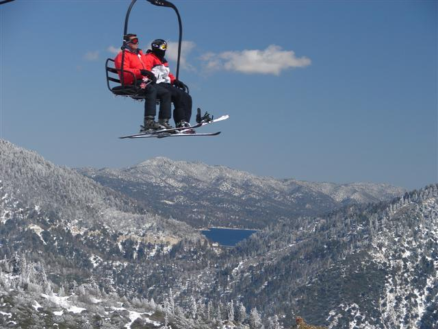 Snowboarders take the chairlift up Snow Valley, California