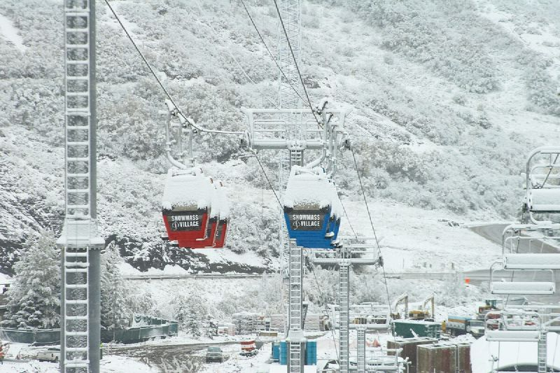 A scenic view of the gondolas and chair lifts at Snowmass, Colorado