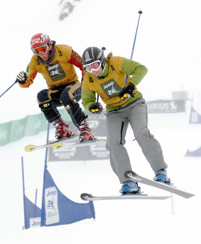 Two racers compete in the Jeep King of the Mountain Skiing/Snowboarding World Championships at Squaw Valley, California in February, 2006