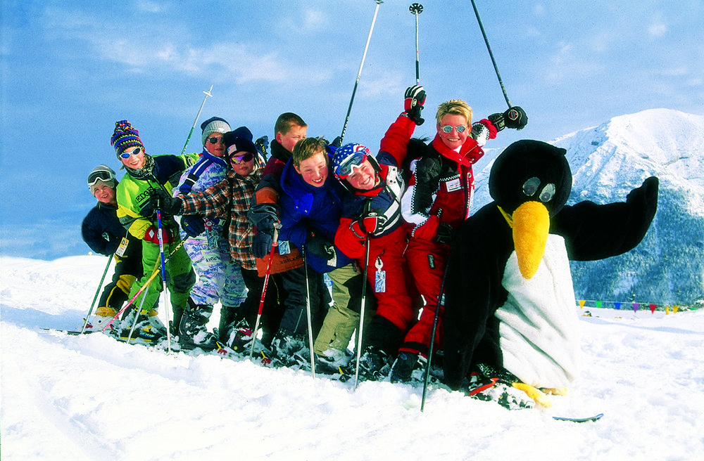 Kids and a penguin mascot at Hochfugen, AUT.