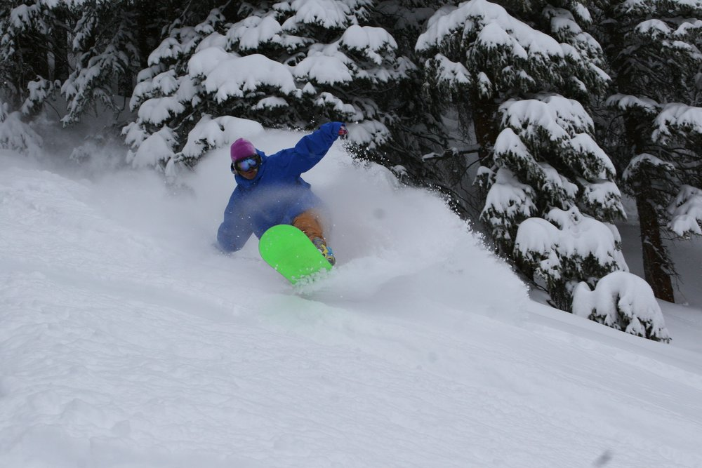 A snowboarder surfing the powder at Copper Mtn. CO.