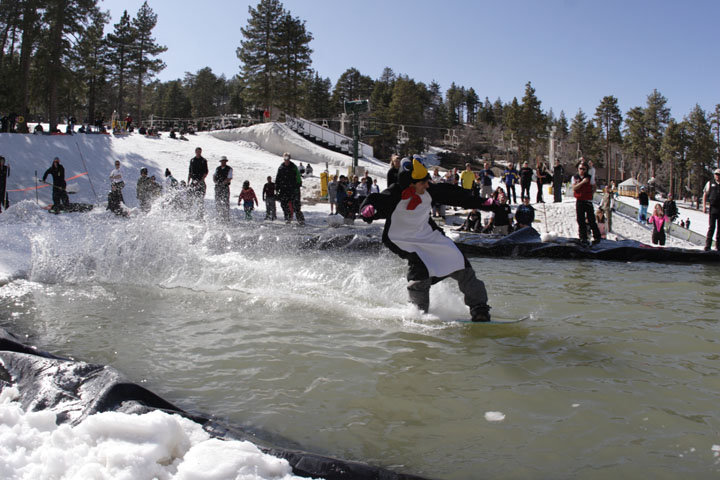 A snowboarder at Mt. High's spring pondskim