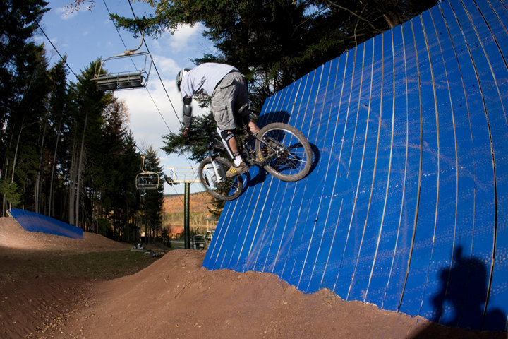 Mountain biker on ramp obstacle at Snowshoe - ©Snowshoe