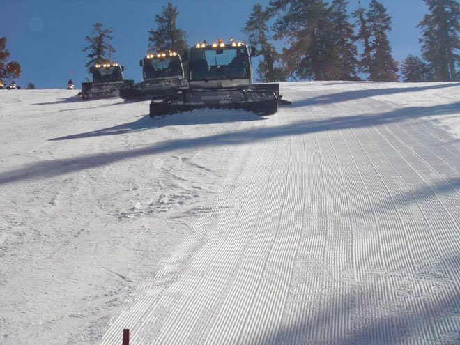 Snowcats groom a run at Sierra-at-Tahoe, California