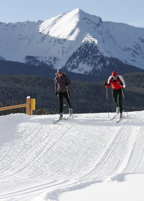 Crosscountry skiers at Breckenridge, CO. Image by Joe Kusumoto.