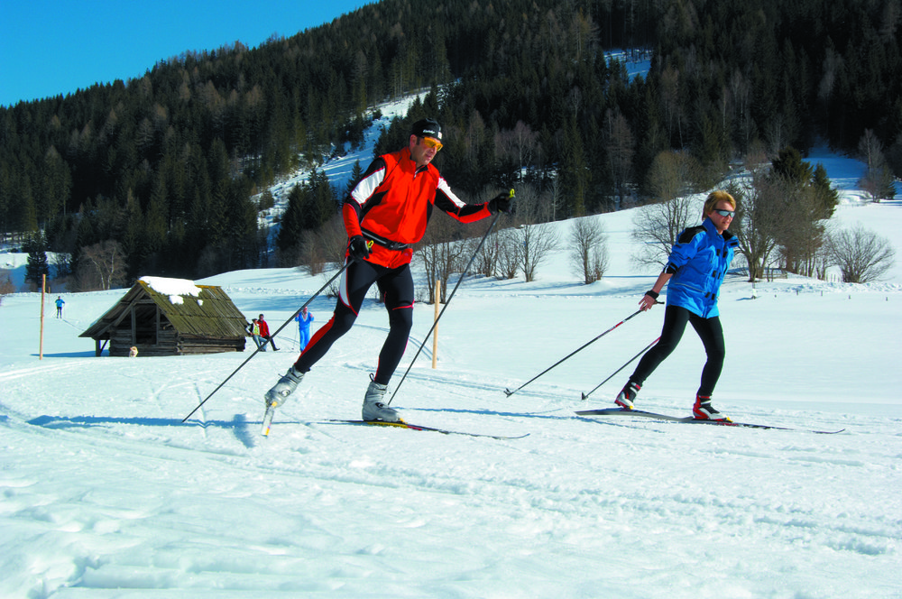 Cross country skiing couple in Bad Kleinkirchheim, Austria
