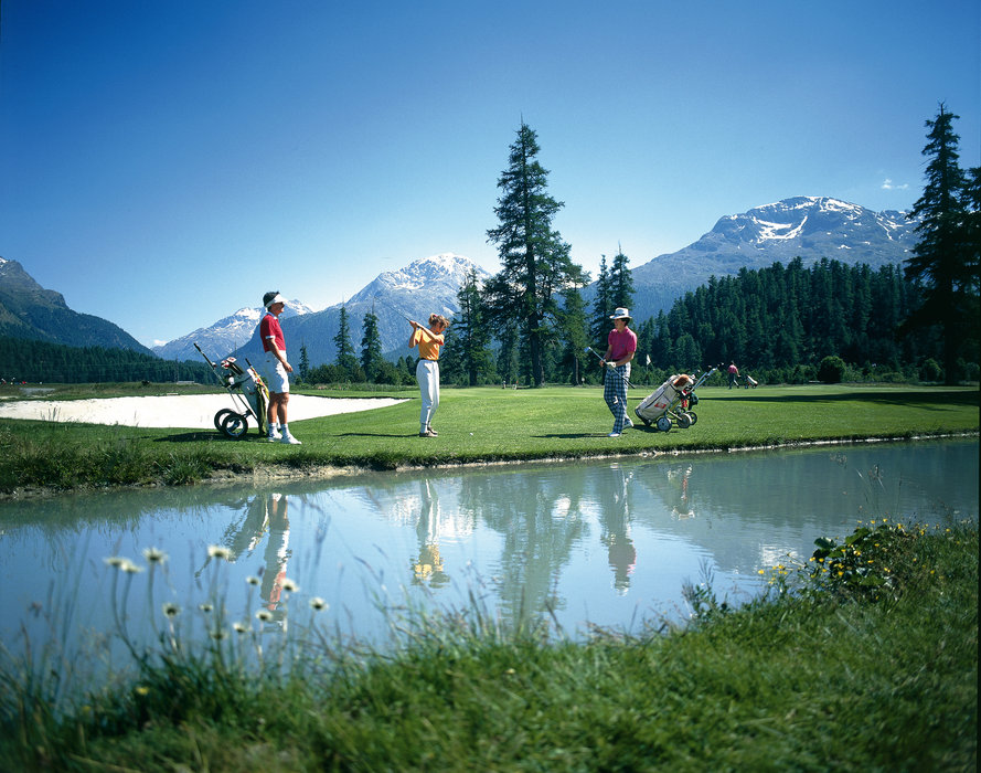 Switzerland. get natural. . Golf in St. Moritz. The 18 hole course 'Engadine Golf Samedan' was opened in 1891, making it Switzerland's oldest golf course. . . Schweiz. ganz natuerlich. . Golf in St. Moritz. Der 18 Loch 'Engadin Golf Samedan' eroeffnete 1891 und war der erste Golfplatz der Schweiz. .