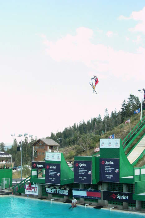 A ski jumper about to land in the Splash Pool at Utah Olympic Park.