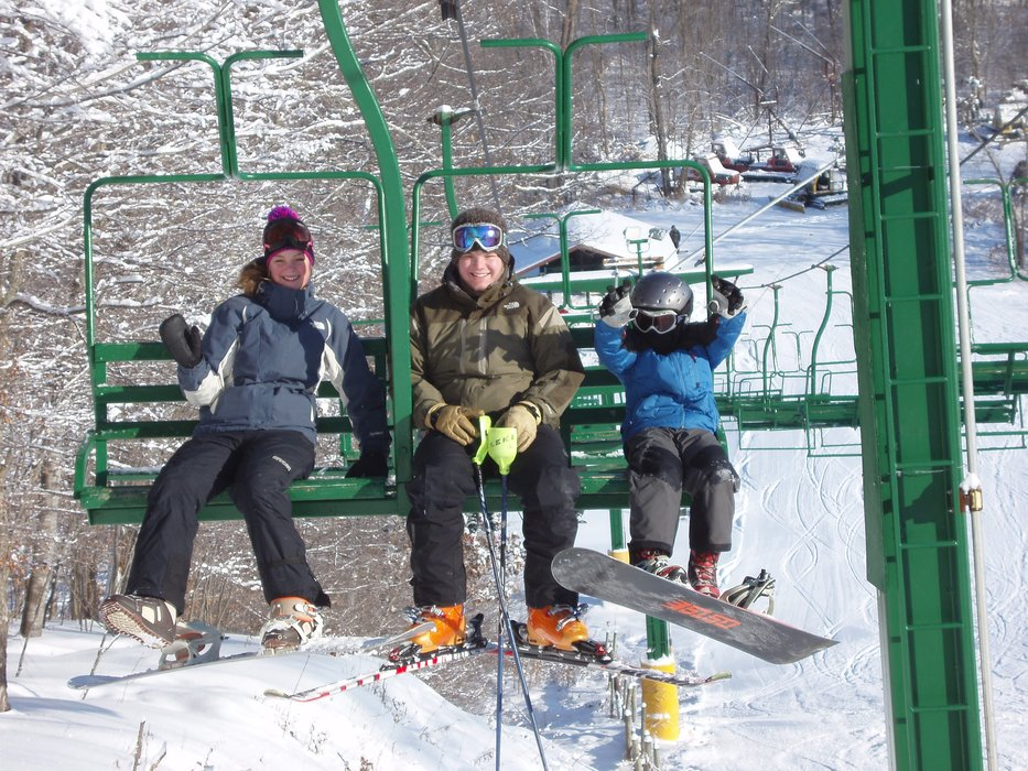 A skier and boarders on a chairlift at Wild Mountain, MN