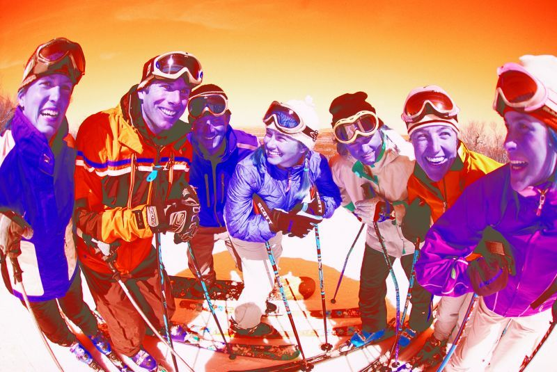 Group of skiers smiling on mountain