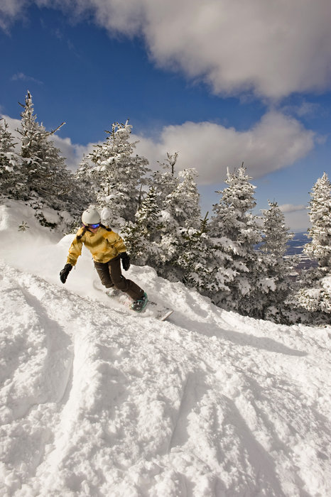 A snowboarder in thick snow at Smugglers' Notch, Vermont.