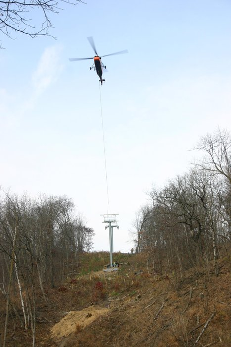 Helicopter aiding ski lift construction at Welch VIllage, MN.