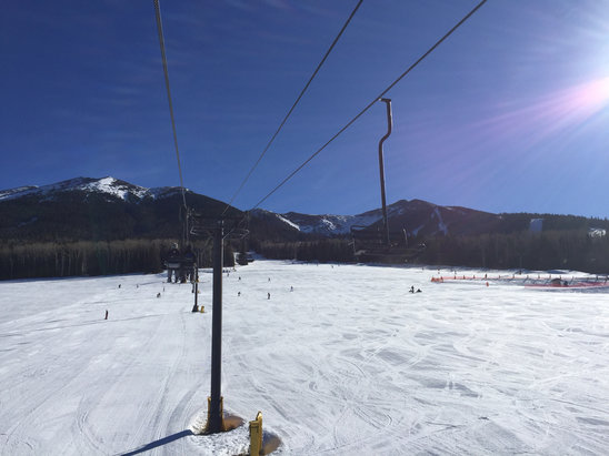 Arizona Snowbowl - Busy busy busy today.  Sometimes 15-20 wait for certain lifts.  Good pow pow at first open, ice then slush towards noon/afternoon.  Had to pull off jacket and just got long shirt after 11am.  Runs are open from 8:30 to 4:30 this weekend (usually 9-4).    - ©Chris's IPhone