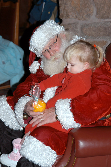 Santa with a child at Snowbasin, UT.