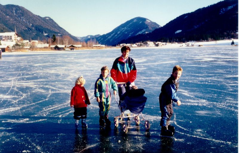 A family crossing an icy expanse in Nassfeld, AUT.