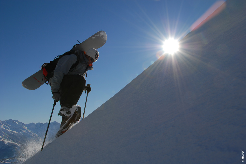 Snowboarder hiking to backcountry on snowshoes. PHOTO CREDIT: -- Photo courtesy of TSL Outdoor