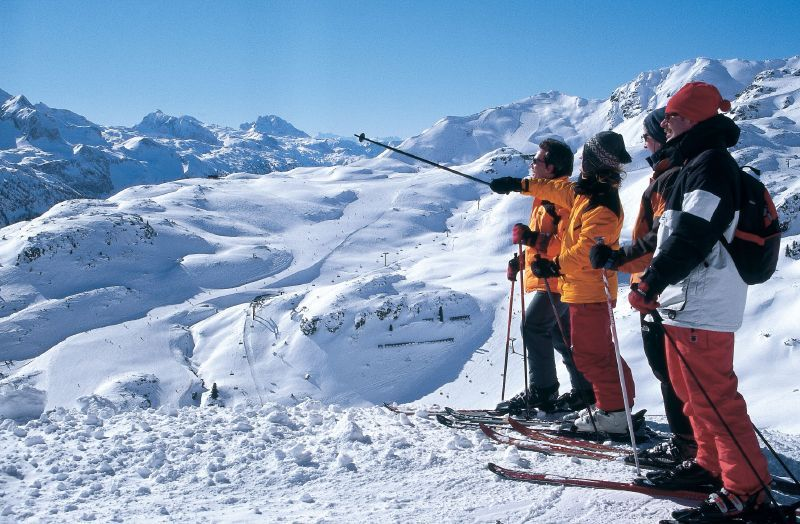 A group of skiers taking in the view of Obertauern