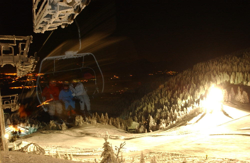 Night skiers at Le Collet d'Allevard, France.