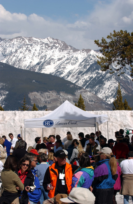 Amid the glory of Colorado's High Country, attendees of a recent Taste of Vail enjoy samples from chefs at restaurants throughout the Vail Valley during the festival's annual Mountaintop Picnic. The picnic  takes place atop Vail Mountain at 10,350 feet above sea level.                      