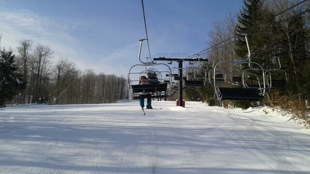 Peek'n Peak - Nice conditions today and no lines.  Sun is teasing us behind the clouds. - ©go ski it