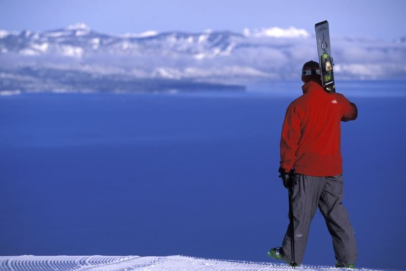 A skier takes a look out on Lake Tahoe from Heavenly Mountain Resort in South Lake Tahoe, California