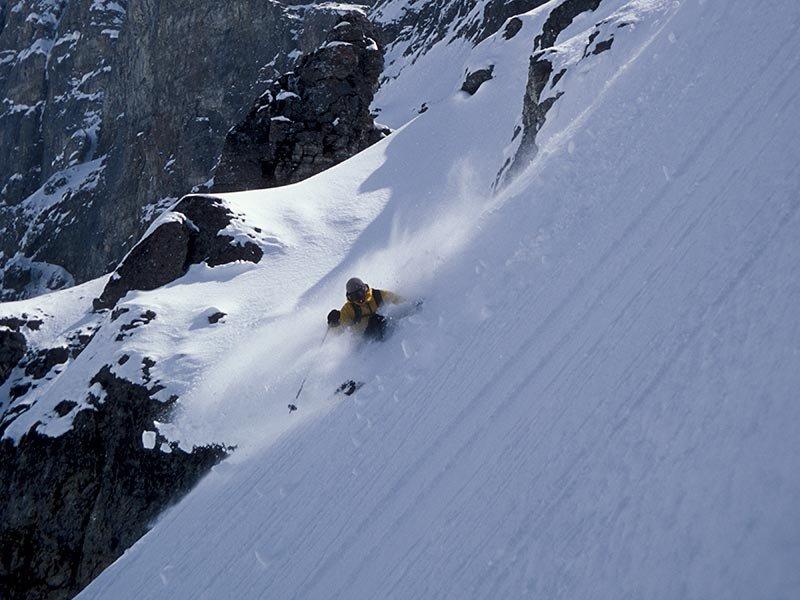 A skier enjoys steep powder in Sunshine Village Alberta