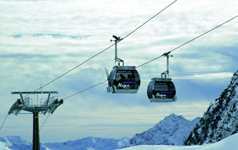 Gondolas taking skiers up the mountain in Alagna