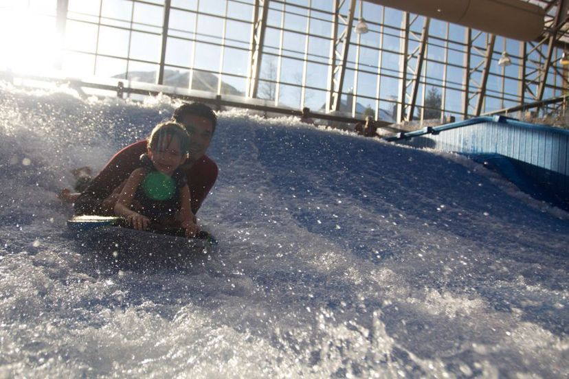 Rip waves in the dead of winter on the Flow Rider at Jay Peak's indoor waterpark.