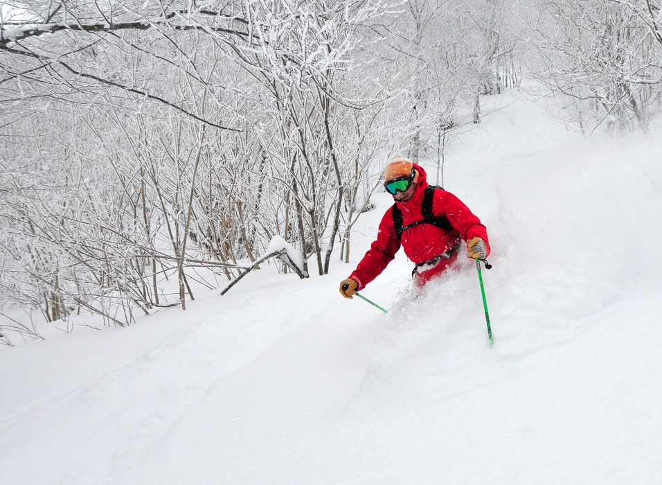 A skier blasts through waist-deep pow at Mad River Glen