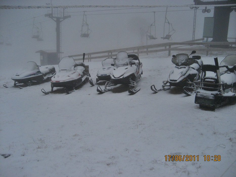 Snowmobiles next to the chairlift in Selwyn Snowfields, Australia
