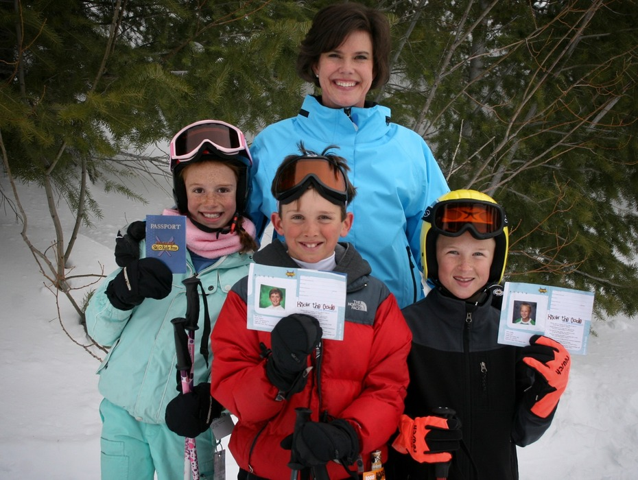 Lori Otter, wife of Idaho's governor, poses with Ski Idaho Passport kids. Photo courtesy of Ski Idaho.