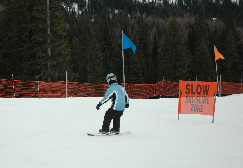 A young snowboarder works on beginner runs at Schweitzer. Photo by Becky Lomax.