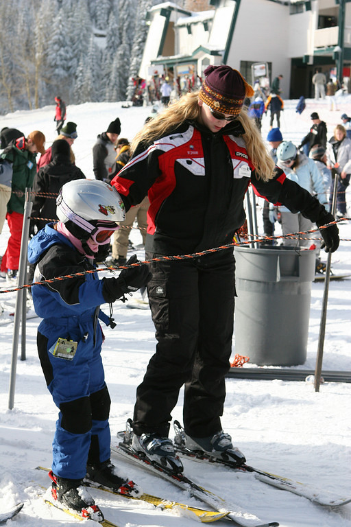 A ski instructor leads a young skier onto the lift at Mt. Spokane. Photo courtesy of Ski NW Rockies.