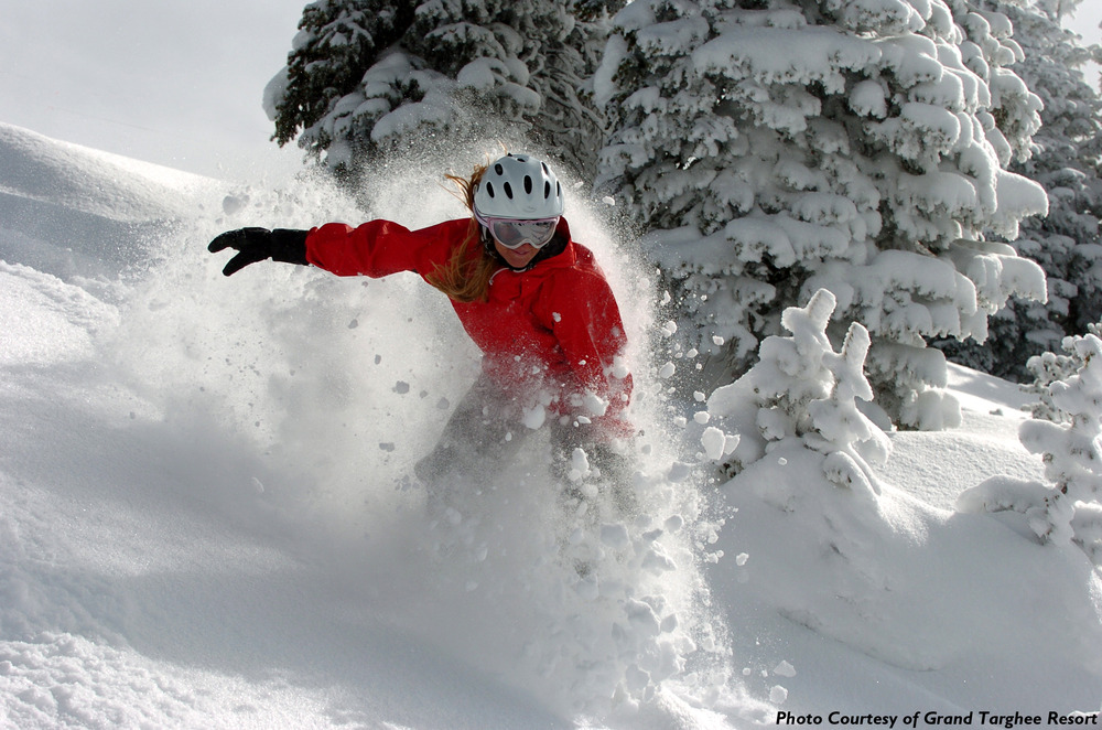 Snowboarding on a powder day at Grand Targhee.Photo courtesy of Grand Targhee Resort
